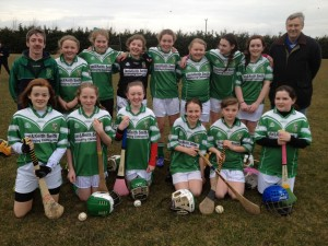 Under 14 Camogie Team with mentors Damien Pearson and John Murphy